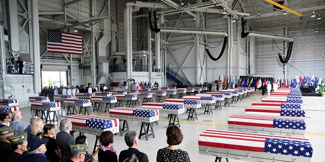 Caskets containing the remains of American servicemen from the Korean War handed over by North Korea arrive at Joint Base Pearl Harbor-Hickam in Honolulu, Hawaii, U.S., August 1, 2018. REUTERS/Hugh Gentry - RC1490AADB00