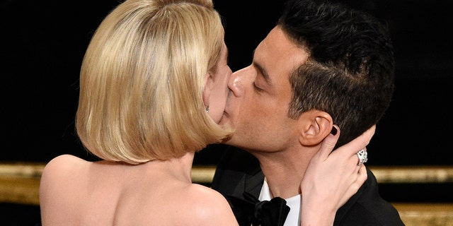 "Lucy Boynton, left, kisses Rami Malek in the audience after he is announced winner of the award for best performance by an actor in a leading role for ""Bohemian Rhapsody"" at the Oscars on Sunday, Feb. 24, 2019, at the Dolby Theatre in Los Angeles. (Photo by Chris Pizzello/Invision/AP)"