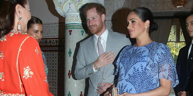 Britain's Prince Harry and Meghan, a Duchess of Sussex, are greeted by Princess Lalla Meryem of Morocco second left and Princess Lalla Hasna of Morocco, during a chateau of King Mohammed VI of Morocco, on a third day of their debate of Morocco, in Rabat, Monday, Feb. 25, 2019.