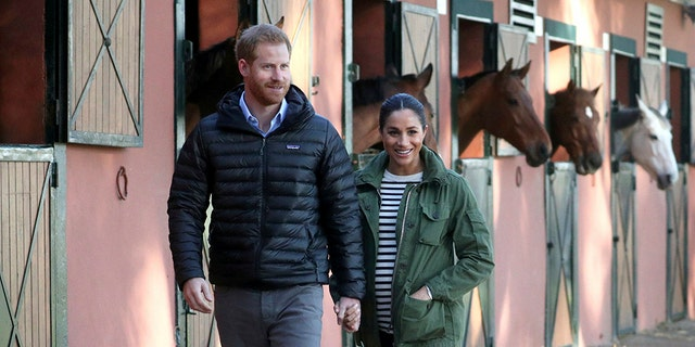 Britain's Prince Harry and Meghan, Duchess of Sussex, visit the Moroccan Royal Federation of Equitation Sports in Rabat, Morocco, Monday Feb. 25, 2019. The royal couple are expecting their first child in Spring 2019.