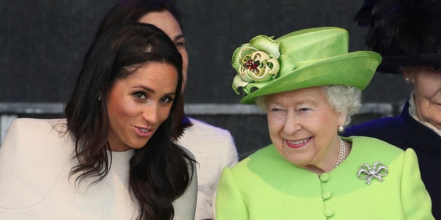 Britain's Queen Elizabeth II and Meghan, the Duchess of Sussex, left, attend the opening of the new Mersey Gateway Bridge, in Widnes, northwest England, Thursday June 14, 2018.