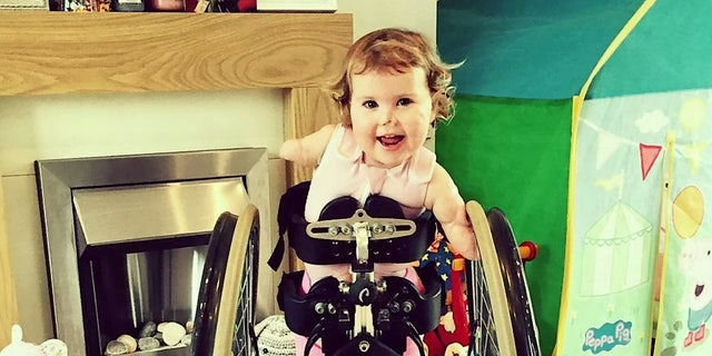Harmonie-Rose will mostly be pushed around the course in her wheelchair, but her family hope she will be able to run the last few meters on her prosthetic legs.