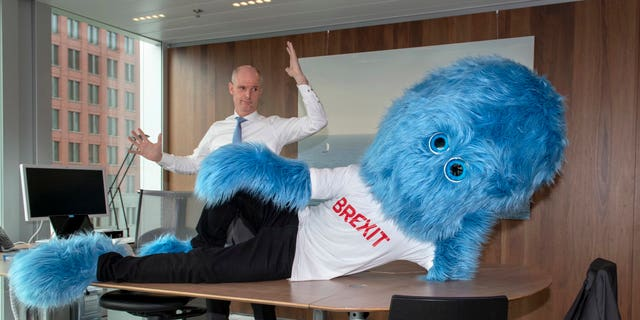 """Foreign Minister Stef Blok tweeted the picture of a giant monster mascot laying on his desk sporting a """"Brexit"""" T-shirt. """"Make sure Brexit doesn't sit – or lie – in your way,"""" Blok wrote."""