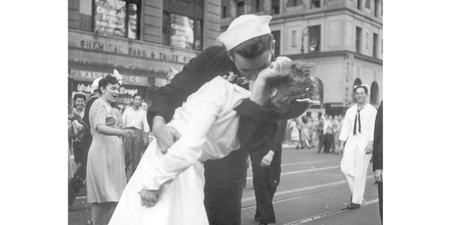 In this Aug. 14, 1945 file photo provided by the U.S. Navy, a sailor and a woman kiss in New York's Times Square, as people celebrate the end of World War II.