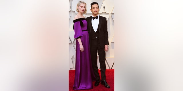 Lucy Boynton, left, and Rami Malek arrive at the Oscars on Sunday, Feb. 24, 2019, at the Dolby Theatre in Los Angeles. (Photo by Richard Shotwell/Invision/AP)