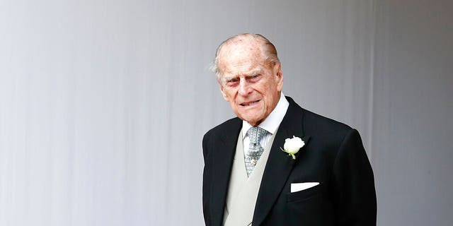 Britain's Prince Philip waits for the bridal procession following the wedding of Princess Eugenie of York and Jack Brooksbank in St George's Chapel, Windsor Castle, near London, England in 2018.
