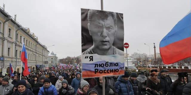 """People attend a rally in memory of Russian opposition politician Boris Nemtsov, who was assassinated in 2015, in Moscow, Russia February 24, 2019. The placard reads """"I love Russia""""."""