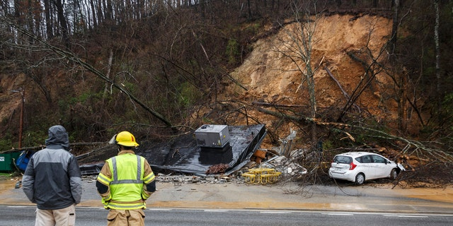 Emergency workers survey damage after an overnight mudslide destroyed a Subway restaurant on Signal Mountain Road in Chattanooga, Tenn., Saturday, Feb. 23, 2019.
