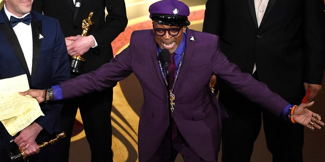 "Charlie Wachtel, left, and Spike Lee accept the award for best adapted screenplay for ""BlacKkKlansman"" at the Oscars on Sunday, Feb. 24, 2019, at the Dolby Theatre in Los Angeles. (Photo by Chris Pizzello/Invision/AP)"