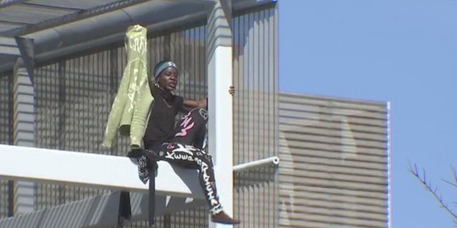 Therese Patricia Okoumou spent nearly 8 hours on the Southwest Key building in East Austin.