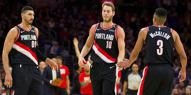 Enes Kanter #00, Jake Layman #10, and CJ McCollum #3 of the Portland Trail Blazers react against the Philadelphia 76ers in the fourth quarter at the Wells Fargo Center on February 23, 2019, in Philadelphia, Pennsylvania. The Trail Blazers defeated the 76ers 130-115. (Photo by Mitchell Leff/Getty Images)