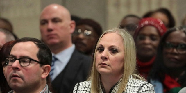 In this Friday, Jan. 18, 2019 file photo, Tiffany Van Dyke, wife of former Chicago police Officer Jason Van Dyke, attends his sentencing hearing at the Leighton Criminal Court Building, in Chicago, for the 2014 shooting of Laquan McDonald.