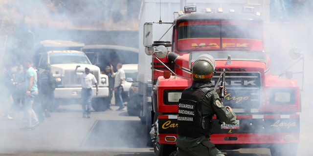Lawmaker members of the Venezuelan National Assembly and supporters of Juan Guaido, who many nations have recognized as the country's rightful interim ruler, clash with security forces as they block the road on the outskirts of Mariara, Venezuela February 21.