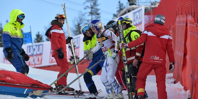 United States' Lindsey Vonn is assisted after crashing during the women's super G at the alpine ski World Championships, in Are, Sweden, Tuesday, Feb. 5, 2019.