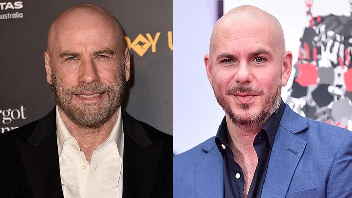 John Travolta says Pitbull help him accept his shaved head