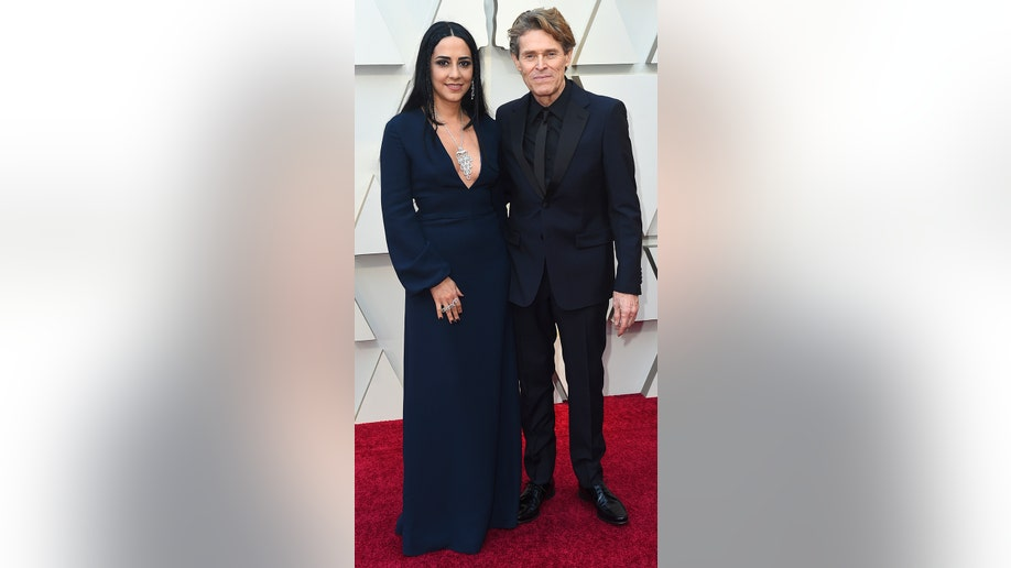 Giada Colagrande, left, and Willem Dafoe arrive at the Oscars on Sunday, Feb. 24, 2019, at the Dolby Theatre in Los Angeles. (Photo by Jordan Strauss/Invision/AP)