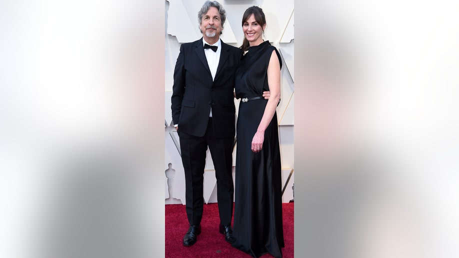 Peter Farrelly, left, and Melinda Kocsis arrive at the Oscars on Sunday, Feb. 24, 2019, at the Dolby Theatre in Los Angeles. (Photo by Richard Shotwell/Invision/AP)