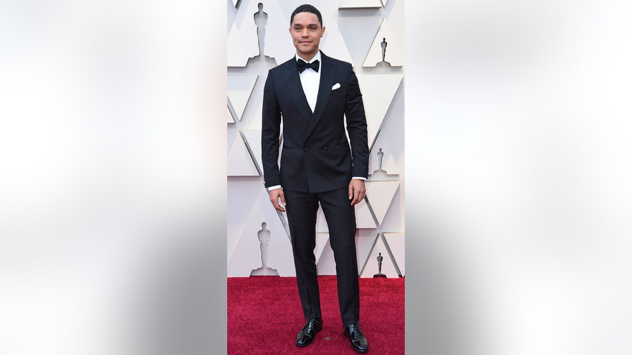 Trevor Noah arrives at the Oscars on Sunday, Feb. 24, 2019, at the Dolby Theatre in Los Angeles. (Photo by Richard Shotwell/Invision/AP)