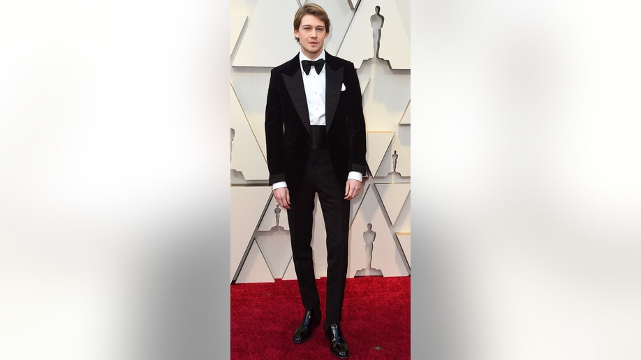 Joe Alwyn arrives at the Oscars on Sunday, Feb. 24, 2019, at the Dolby Theatre in Los Angeles. (Photo by Jordan Strauss/Invision/AP)