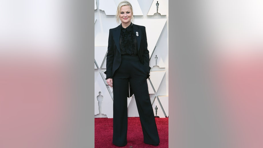 Amy Poehler arrives at the Oscars on Sunday, Feb. 24, 2019, at the Dolby Theatre in Los Angeles. (Photo by Richard Shotwell/Invision/AP)