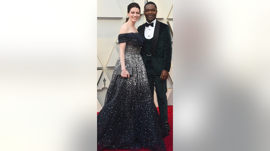 Jessica Oyelowo, left, and David Oyelowo arrive at the Oscars on Sunday, Feb. 24, 2019, at the Dolby Theatre in Los Angeles. (Photo by Jordan Strauss/Invision/AP)