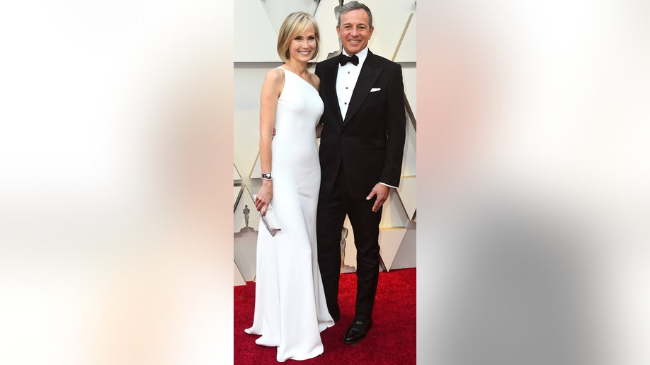 Willow Bay, left, and Robert Iger arrive at the Oscars on Sunday, Feb. 24, 2019, at the Dolby Theatre in Los Angeles. (Photo by Jordan Strauss/Invision/AP)