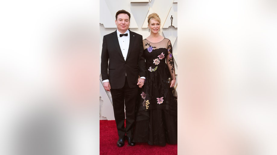 Mike Myers, left, and Kelly Tisdale arrive at the Oscars on Sunday, Feb. 24, 2019, at the Dolby Theatre in Los Angeles. (Photo by Richard Shotwell/Invision/AP)