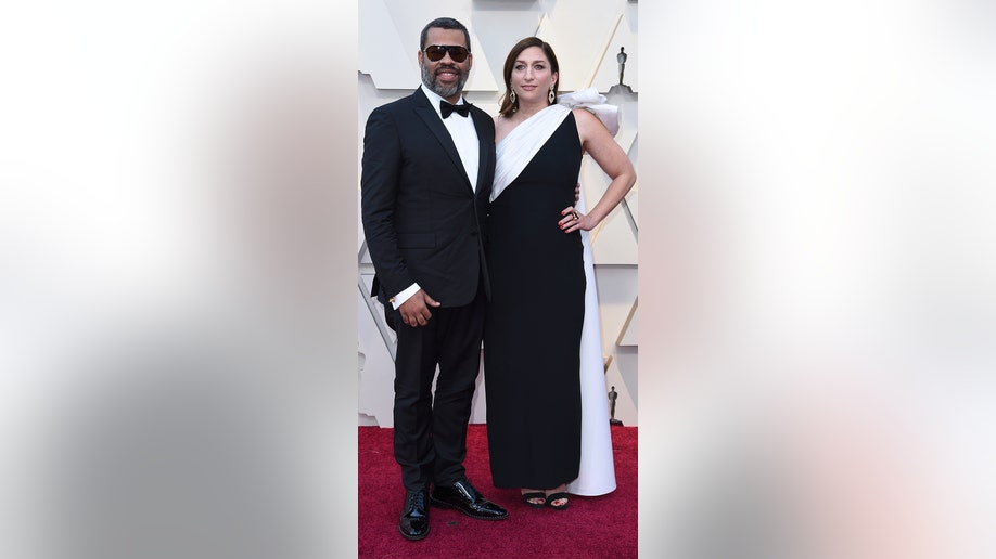 Jordan Peele, left, and Chelsea Peretti arrive at the Oscars on Sunday, Feb. 24, 2019, at the Dolby Theatre in Los Angeles. (Photo by Richard Shotwell/Invision/AP)