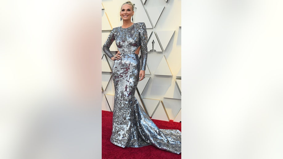 Molly Sims arrives at the Oscars on Sunday, Feb. 24, 2019, at the Dolby Theatre in Los Angeles. (Photo by Jordan Strauss/Invision/AP)