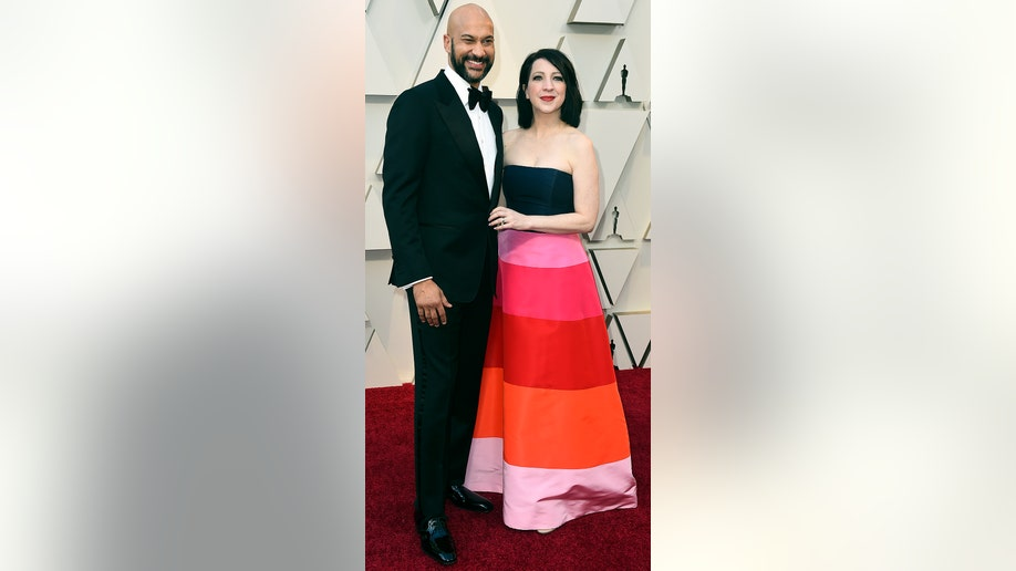 Keegan-Michael Key, left, and Elisa Pugliese arrive at the Oscars on Sunday, Feb. 24, 2019, at the Dolby Theatre in Los Angeles. (Photo by Jordan Strauss/Invision/AP)
