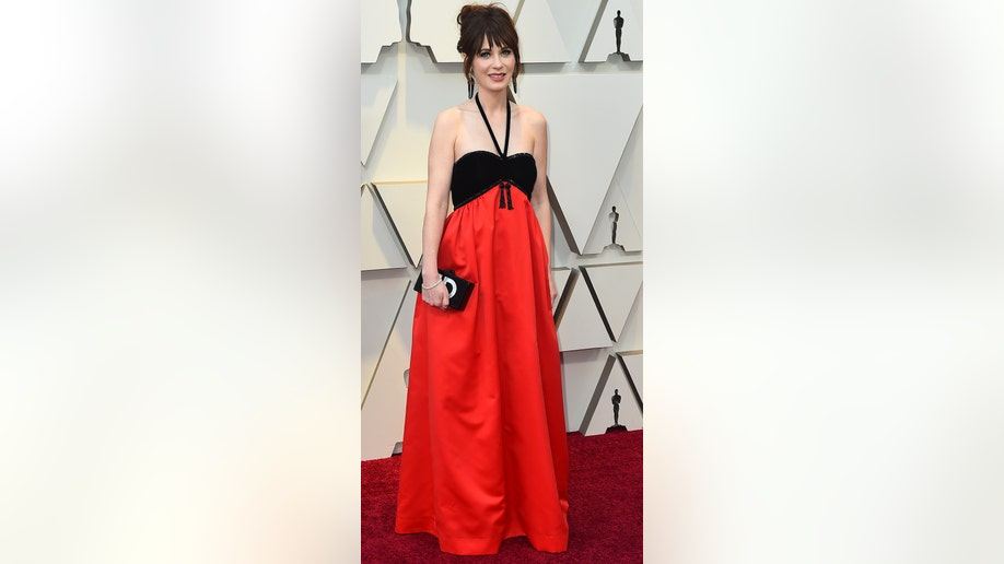 Zooey Deschanel arrives at the Oscars on Sunday, Feb. 24, 2019, at the Dolby Theatre in Los Angeles. (Photo by Jordan Strauss/Invision/AP)