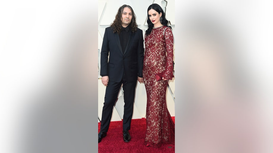 Krysten Ritter, right, and Adam Granduciel arrive at the Oscars on Sunday, Feb. 24, 2019, at the Dolby Theatre in Los Angeles. (Photo by Jordan Strauss/Invision/AP)