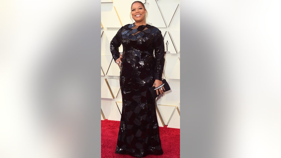 Queen Latifah arrives at the Oscars on Sunday, Feb. 24, 2019, at the Dolby Theatre in Los Angeles. (Photo by Jordan Strauss/Invision/AP)