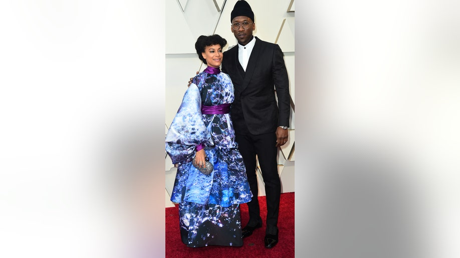 Amatus Sami-Karim, left, and Mahershala Ali arrive at the Oscars on Sunday, Feb. 24, 2019, at the Dolby Theatre in Los Angeles. (Photo by Jordan Strauss/Invision/AP)