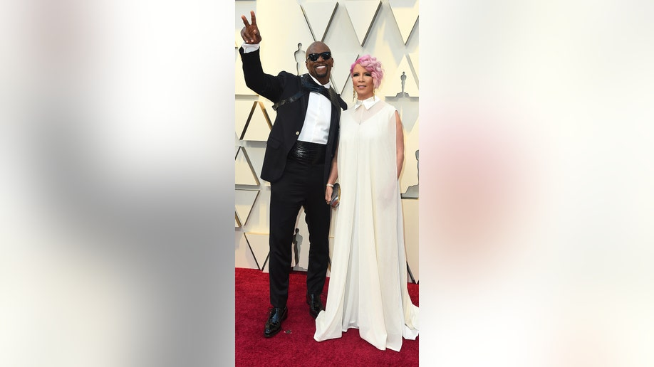 Terry Crews, left, and Rebecca King-Crews arrive at the Oscars on Sunday, Feb. 24, 2019, at the Dolby Theatre in Los Angeles. (Photo by Jordan Strauss/Invision/AP)