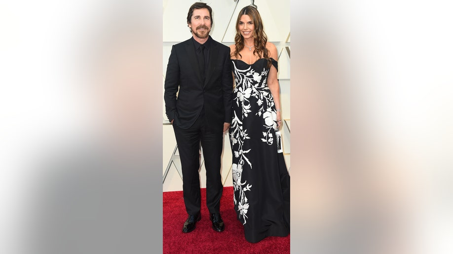 Christian Bale, left, and Sibi Blazic arrive at the Oscars on Sunday, Feb. 24, 2019, at the Dolby Theatre in Los Angeles. (Photo by Jordan Strauss/Invision/AP)