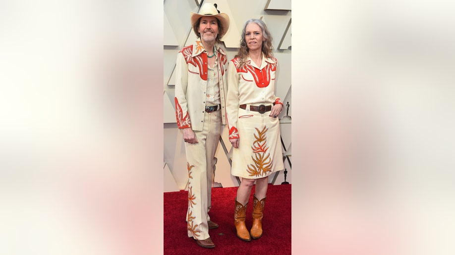 David Rawlings, left, and Gillian Welch arrive at the Oscars on Sunday, Feb. 24, 2019, at the Dolby Theatre in Los Angeles. (Photo by Jordan Strauss/Invision/AP)