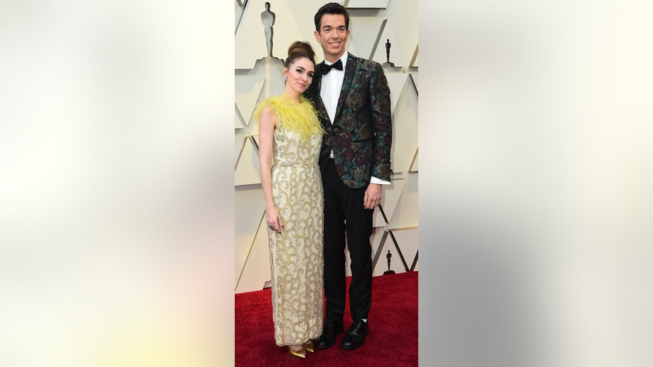 Annamarie Tendler, left, and John Mulaney arrive at the Oscars on Sunday, Feb. 24, 2019, at the Dolby Theatre in Los Angeles. (Photo by Jordan Strauss/Invision/AP)