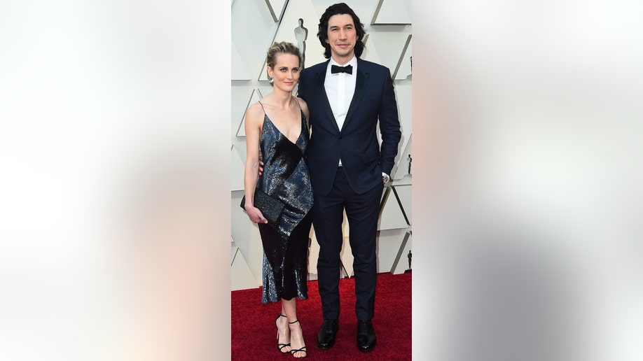 Joanne Tucker, left, and Adam Driver arrives at the Oscars on Sunday, Feb. 24, 2019, at the Dolby Theatre in Los Angeles. (Photo by Jordan Strauss/Invision/AP)