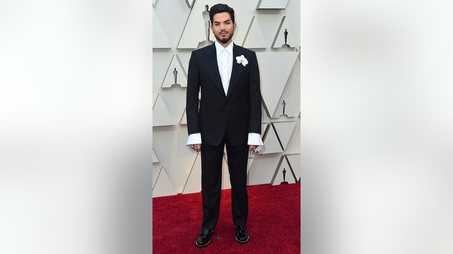 Adam Lambert arrives at the Oscars on Sunday, Feb. 24, 2019, at the Dolby Theatre in Los Angeles. (Photo by Jordan Strauss/Invision/AP)