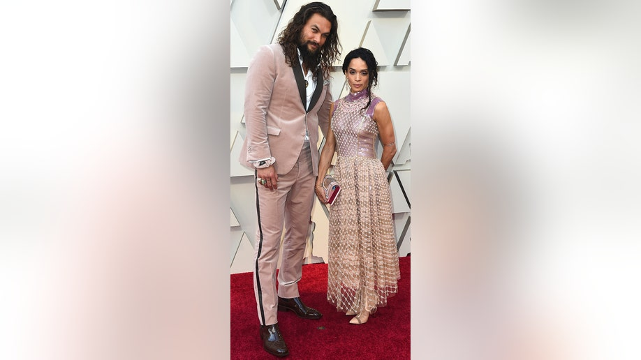 Jason Momoa, left, and Lisa Bonet arrive at the Oscars on Sunday, Feb. 24, 2019, at the Dolby Theatre in Los Angeles. (Photo by Jordan Strauss/Invision/AP)