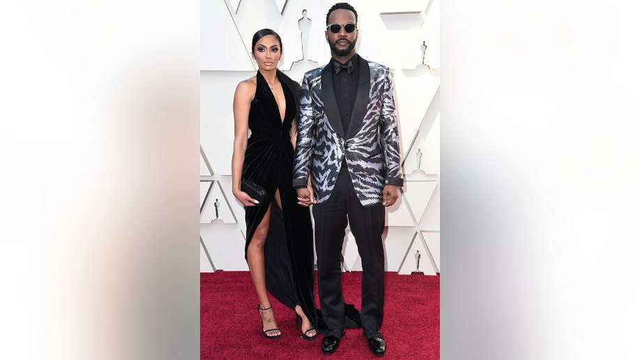 Regina Perera, left, and Juicy J arrive at the Oscars on Sunday, Feb. 24, 2019, at the Dolby Theatre in Los Angeles. (Photo by Richard Shotwell/Invision/AP)