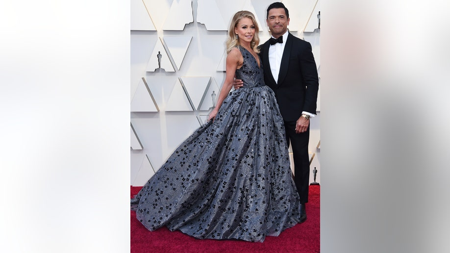 Kelly Ripa, left, and Mark Consuelos arrive at the Oscars on Sunday, Feb. 24, 2019, at the Dolby Theatre in Los Angeles. (Photo by Richard Shotwell/Invision/AP)