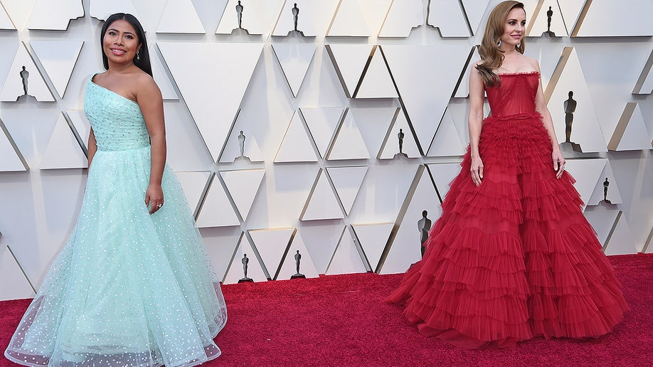 Yalitza Aparicio, left, and Marina de Tavira arrive at the Oscars on Sunday, Feb. 24, 2019, at the Dolby Theatre in Los Angeles. (Photo by Richard Shotwell/Invision/AP)