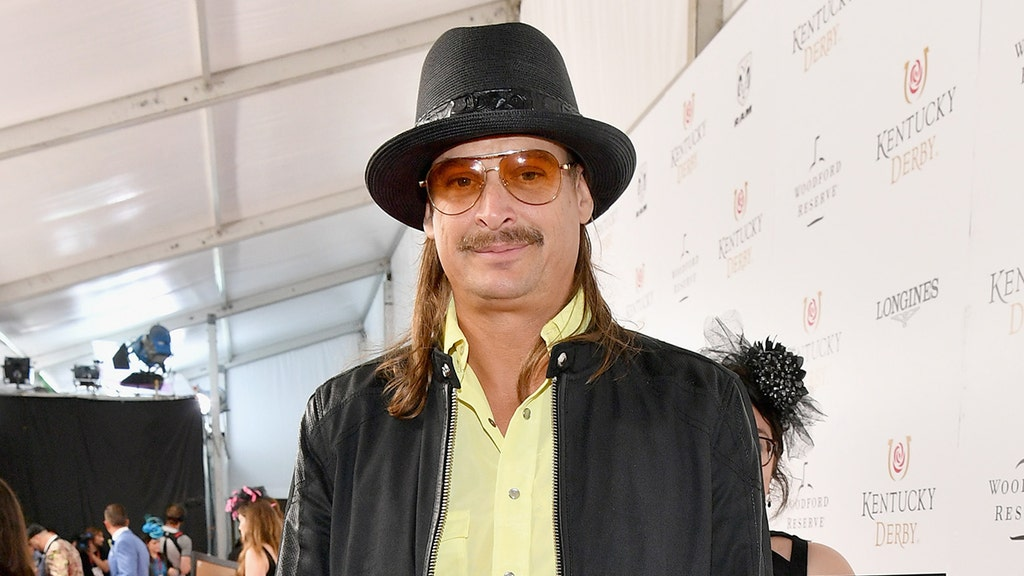 Patriotically attired, Kid Rock hits the links with President Trump