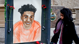 Video of black teen's killing shown at white officer's trial