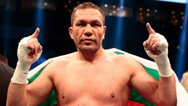 Reporter says boxer Kubrat Pulev's mid-interview kiss on the lips was 'embarrassing' and 'strange'