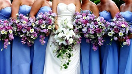 Bride considers barring friend from bridal party for her 'massive breasts'