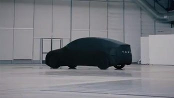 Tesla Model Y teased ahead of reveal in new photo
