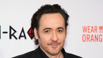 John Cusack defends not standing 'fast enough' for Wrigley Field military salute